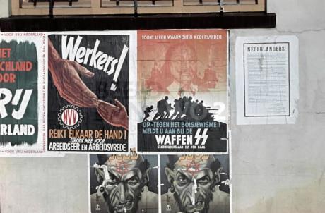 Muur met propaganda-affiches